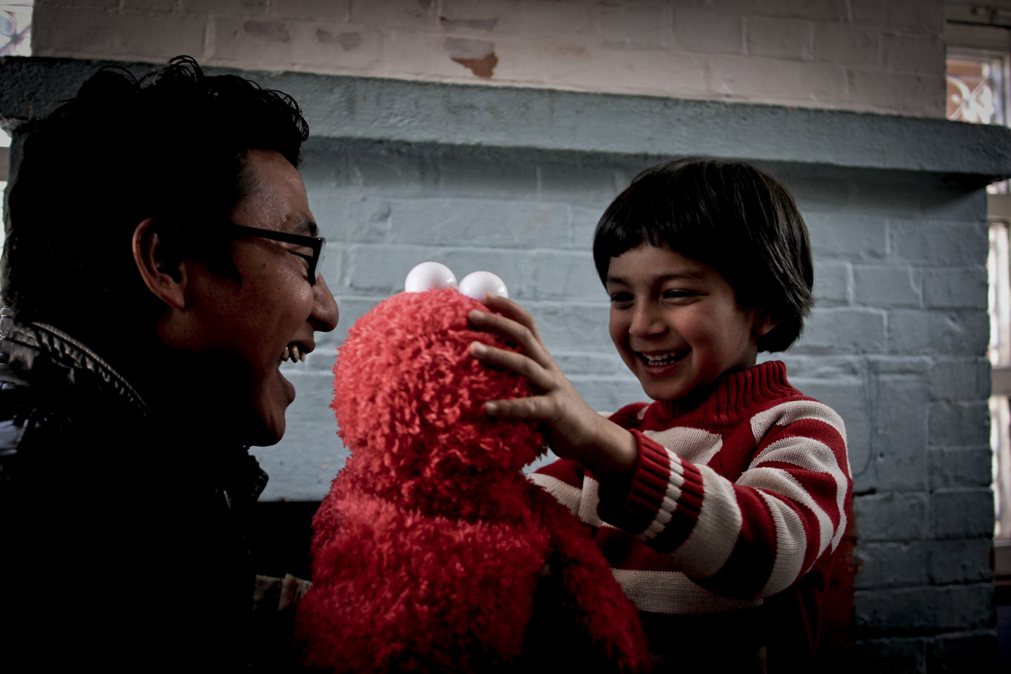 Kreet interacts with a teacher at Autism Care Nepal.